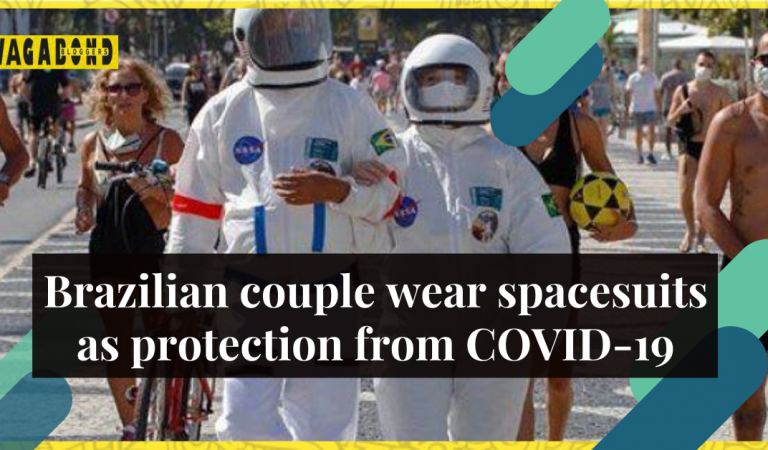 The couple wears spacesuit to beach amid coronavirus pandemic in Brazil.